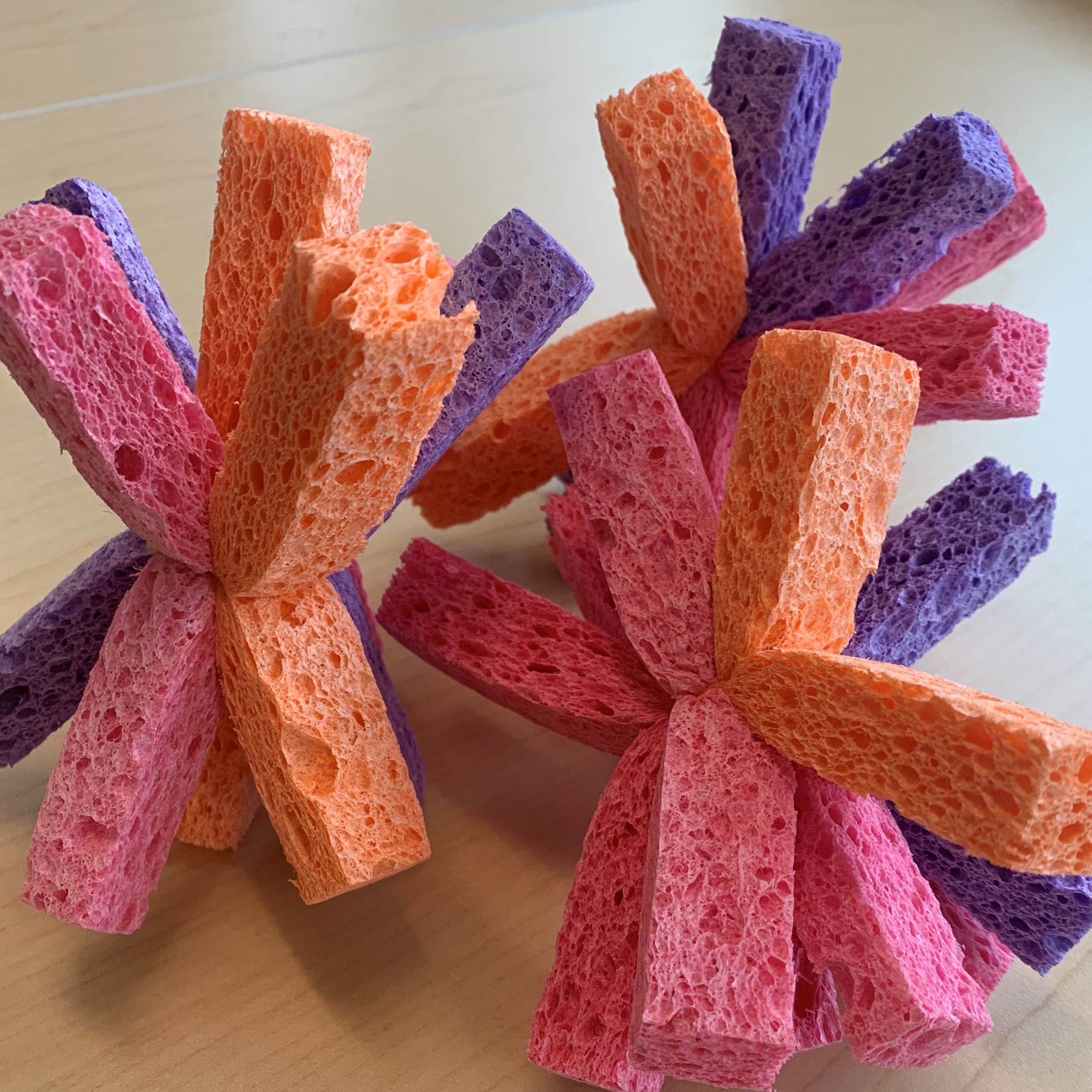 strips of colored sponges tied together