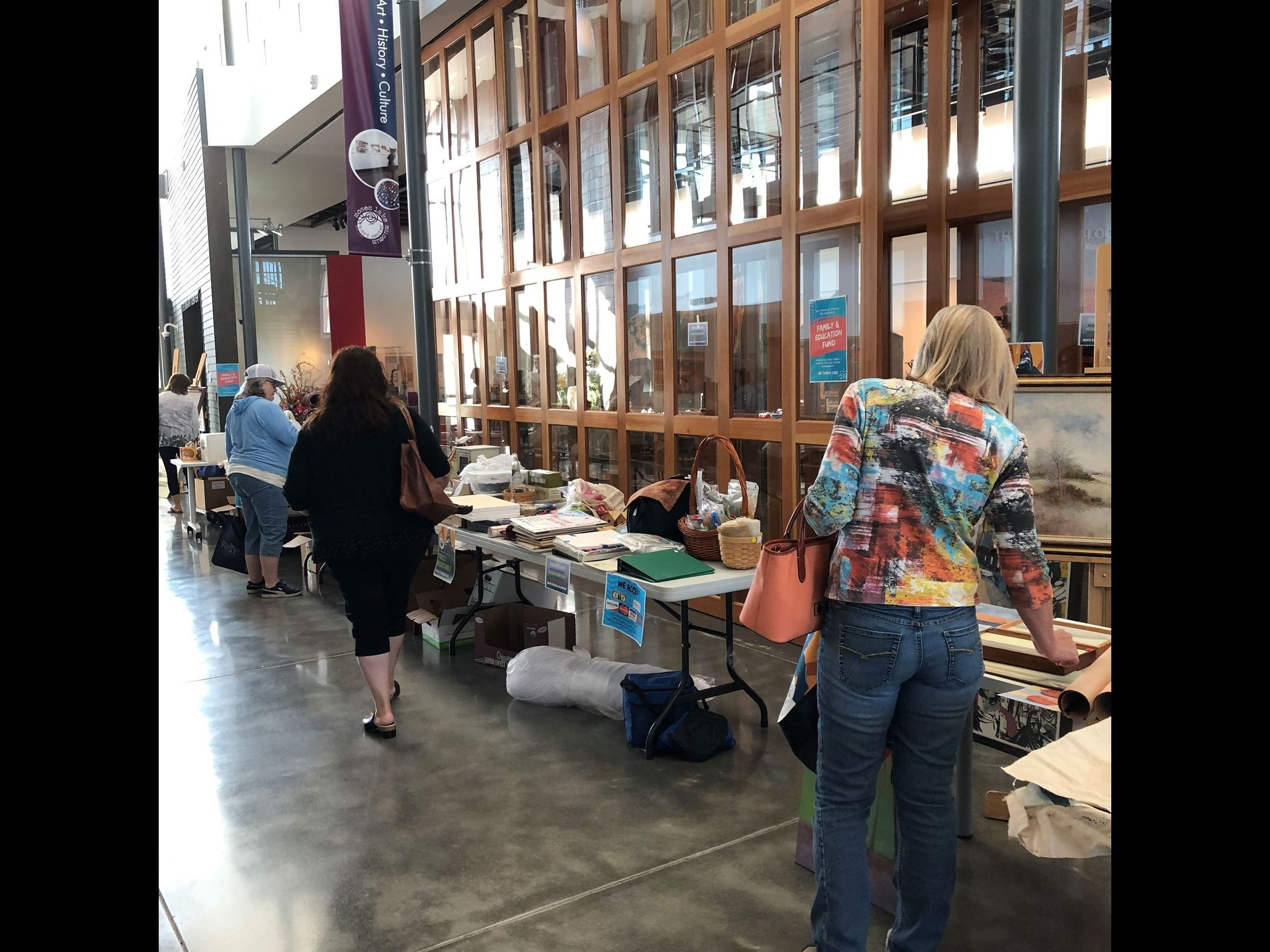 people shopping at rummage sale