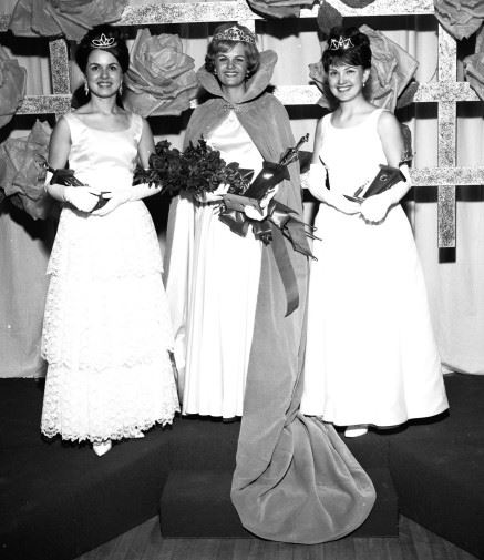 A black and white photograph of three beauty pageant contestants