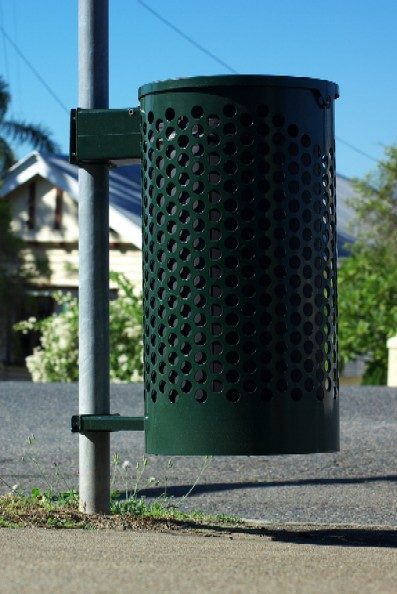Trashcan Attached to a Pole on a Street